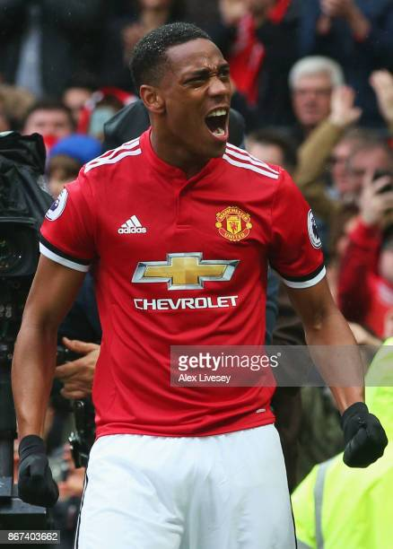 Anthony Martial of Manchester United celebrates scoring his sides first goal during the Premier League match between Manchester United and Tottenham...