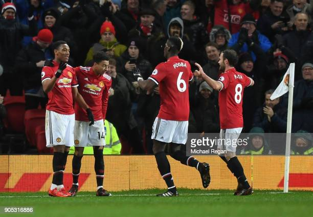 Anthony Martial of Manchester United celebrates scoring his side's second goal with team mates during the Premier League match between Manchester...