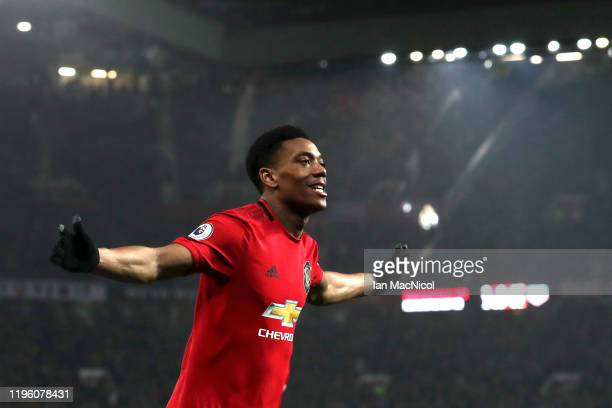 Anthony Martial of Manchester United celebrates scoring his team's fourth goal during the Premier League match between Manchester United and...