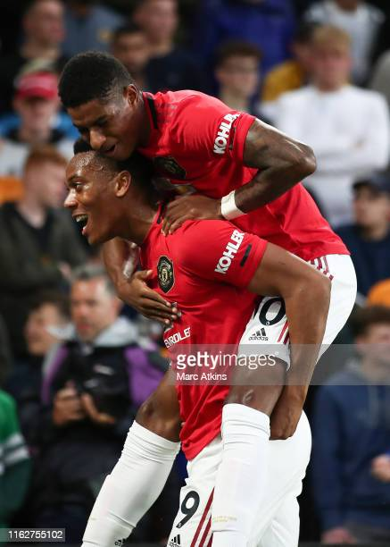 Anthony Martial of Manchester United celebrates scoring the opening goal with Marcus Rashford during the Premier League match between Wolverhampton...
