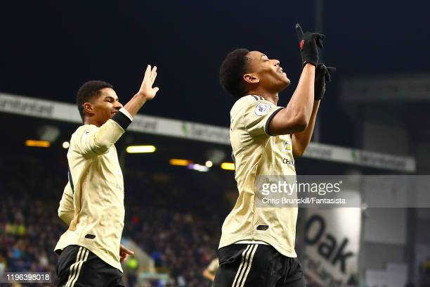 Anthony Martial of Manchester United celebrates scoring the opening goal during the Premier League match between Burnley FC and Manchester United at...