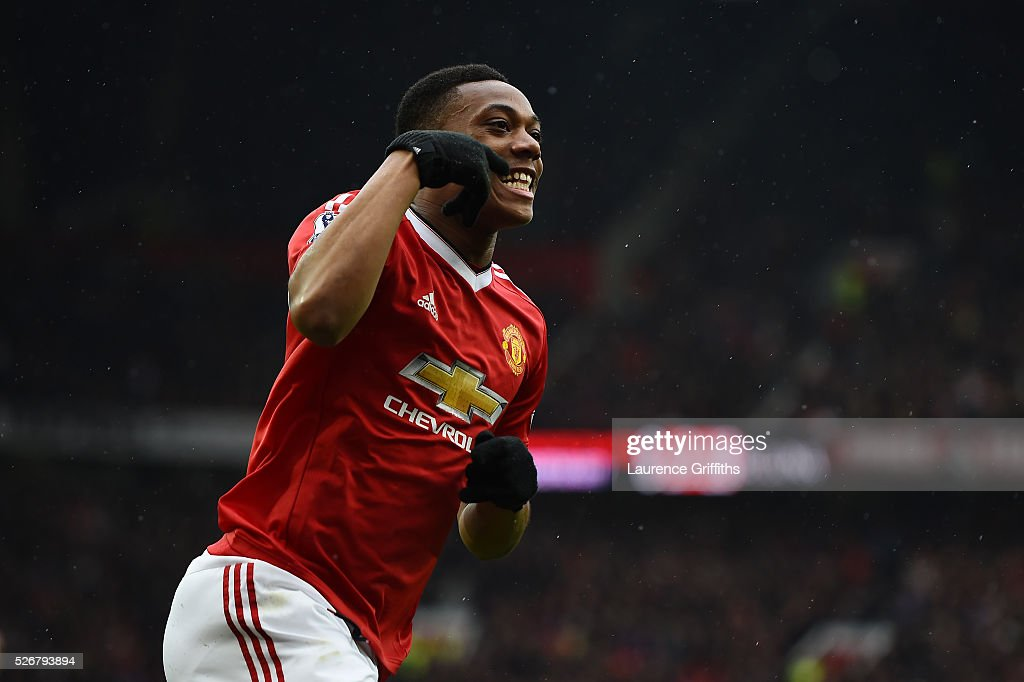 Anthony Martial of Manchester United celebrates scoring the opening goal during the Barclays Premier League match between Manchester United and Leicester City at Old Trafford on May 1, 2016 in Manchester, England.