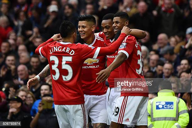 Anthony Martial of Manchester United celebrates scoring the opening goal with team mates during the Barclays Premier League match between Manchester...