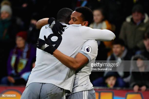 Anthony Martial of Manchester United celebrates scoring the opening goal with teammate Romelu Lukaku during the Premier League match between Burnley...