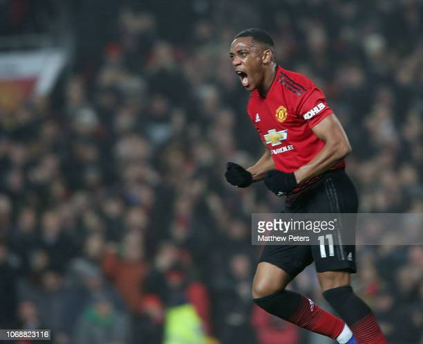 Anthony Martial of Manchester United celebrates scoring their first goal during the Premier League match between Manchester United and Arsenal FC at...