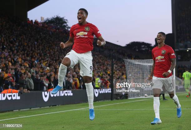 Anthony Martial of Manchester United celebrates scoring their first goal during the Premier League match between Wolverhampton Wanderers and...