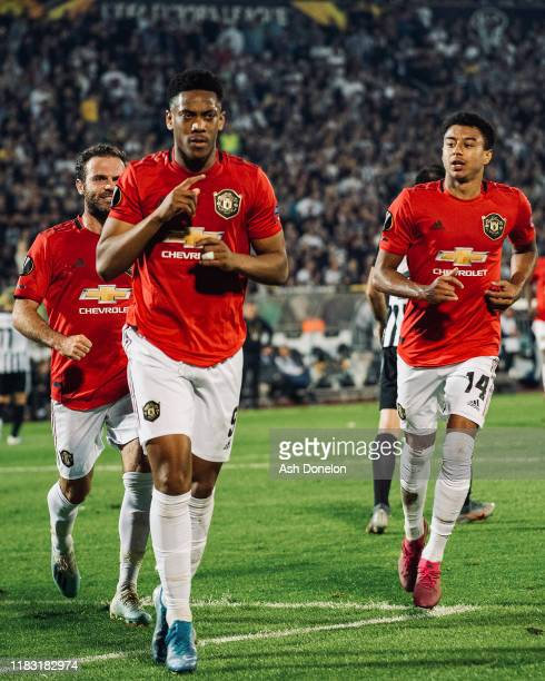 Anthony Martial of Manchester United celebrates scoring their first goal during the UEFA Europa League group L match between Partizan and Manchester...