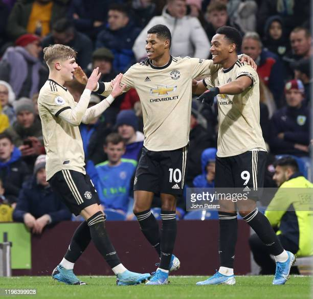 Anthony Martial of Manchester United celebrates scoring their first goal during the Premier League match between Burnley FC and Manchester United at...