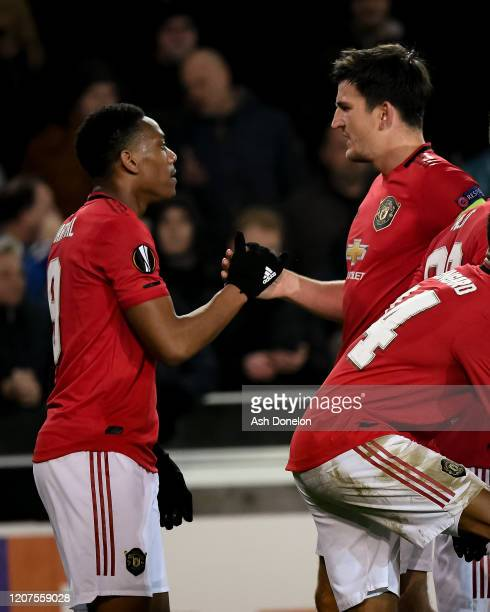 Anthony Martial of Manchester United celebrates scoring their first goal during the UEFA Europa League round of 32 first leg match between Club...