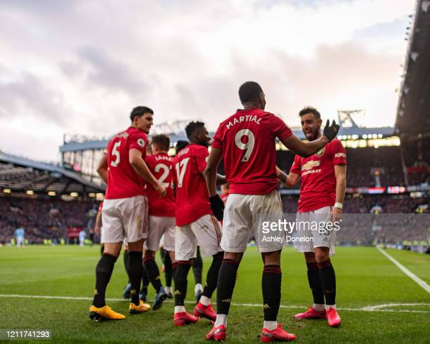 Anthony Martial of Manchester United celebrates scoring their first goal during the Premier League match between Manchester United and Manchester...