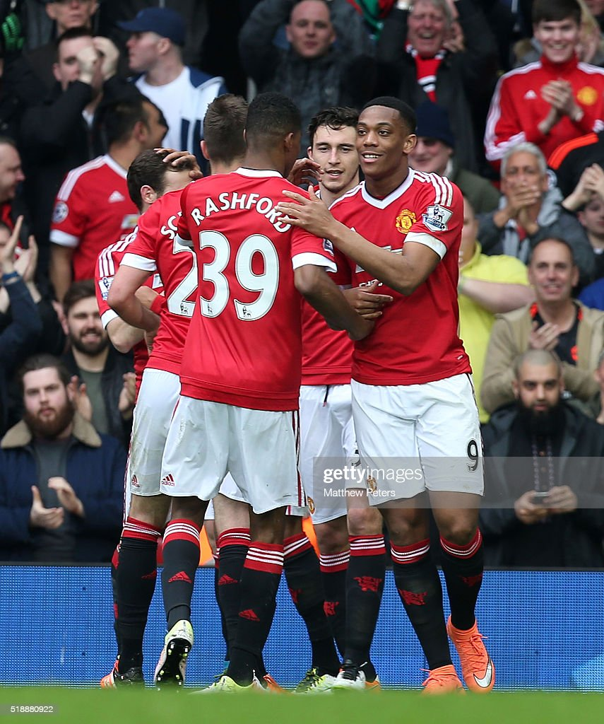 Anthony Martial of Manchester United celebrates scoring their first goal during the Barclays Premier League match between Manchester United and Everton at Old Trafford on April 3, 2016 in Manchester, England.