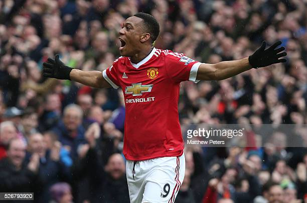 Anthony Martial of Manchester United celebrates scoring their first goal during the Barclays Premier League match between Manchester United and...
