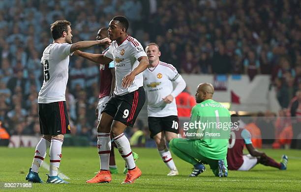 Anthony Martial of Manchester United celebrates scoring their first goal during the Barclays Premier League match between West Ham United and...