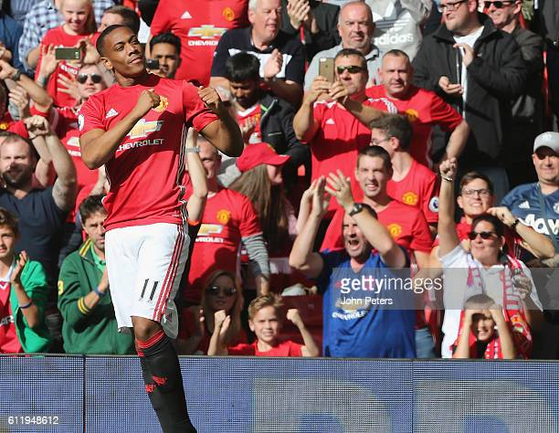 Anthony Martial of Manchester United celebrates scoring their first goal during the Premier League match between Manchester United and Stoke City at...