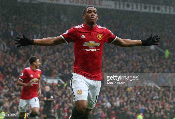 Anthony Martial of Manchester United celebrates scoring their first goal during the Premier League match between Manchester United and Tottenham...