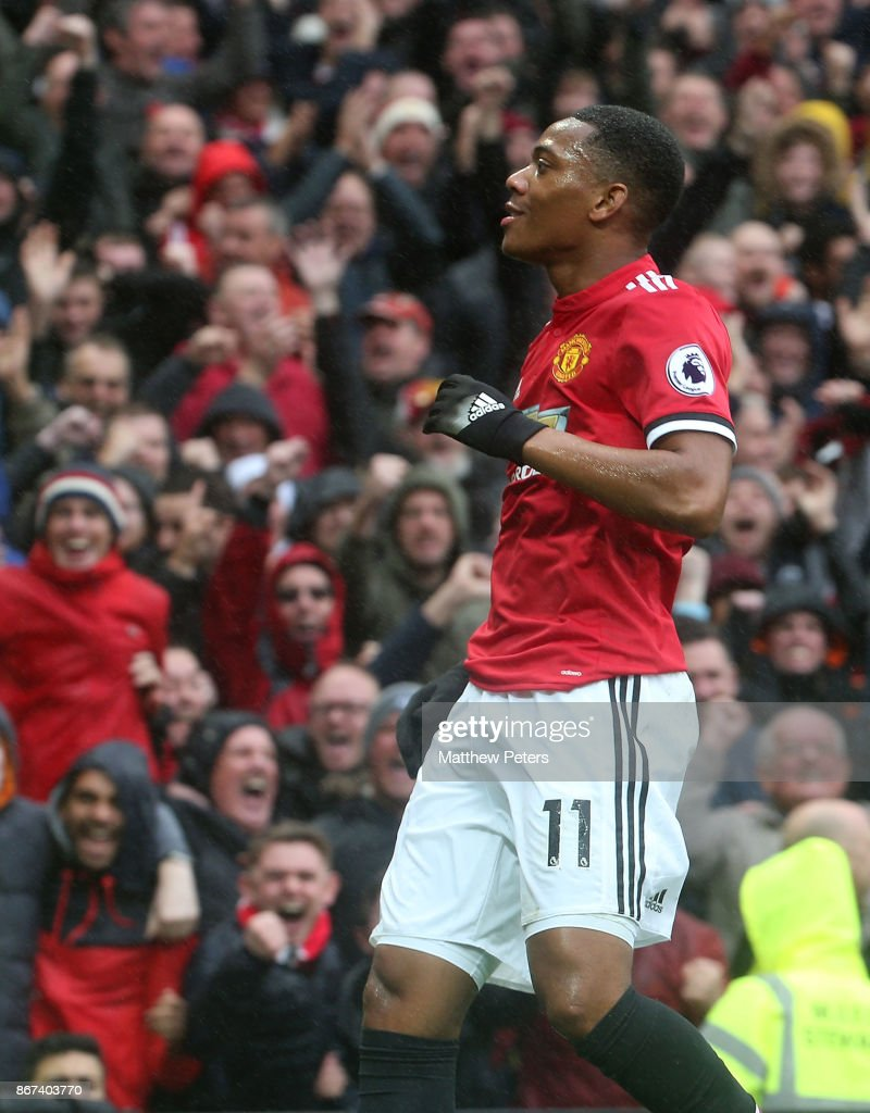 Anthony Martial of Manchester United celebrates scoring their first goal during the Premier League match between Manchester United and Tottenham Hotspur at Old Trafford on October 28, 2017 in Manchester, England.