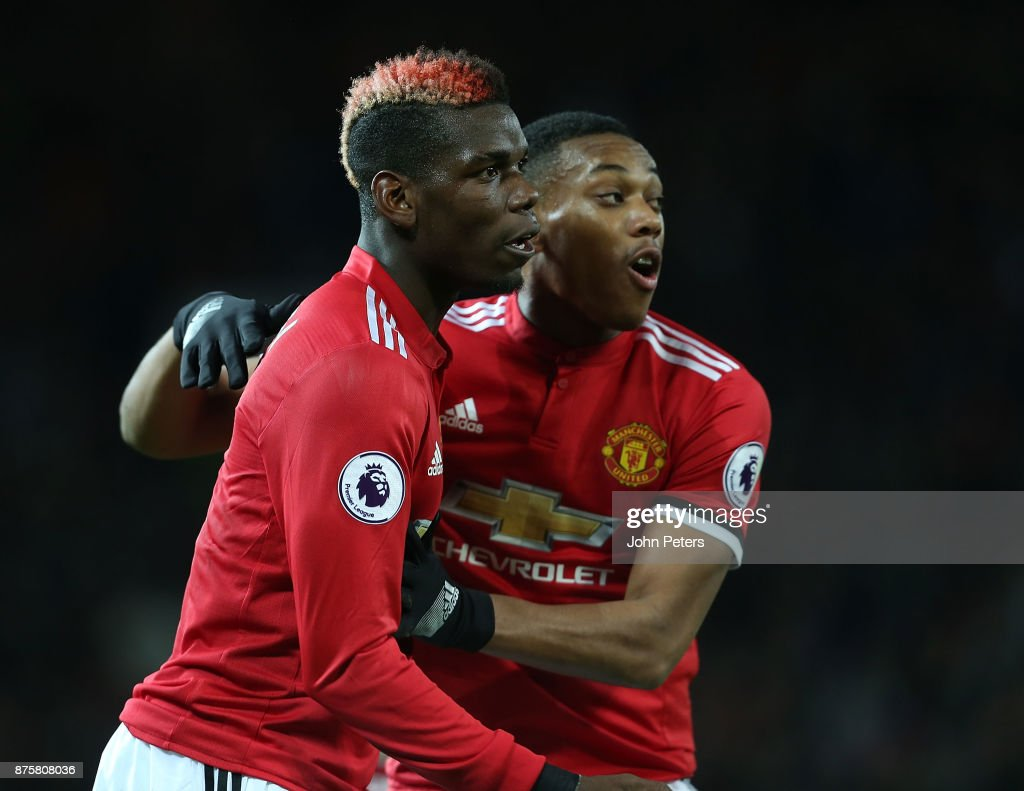 Anthony Martial of Manchester United celebrates scoring their first goal during the Premier League match between Manchester United and Newcastle United at Old Trafford on November 18, 2017 in Manchester, England.