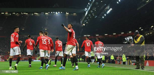 Anthony Martial of Manchester United celebrates scoring their fourth goal during the Premier League match between Manchester United and Newcastle...