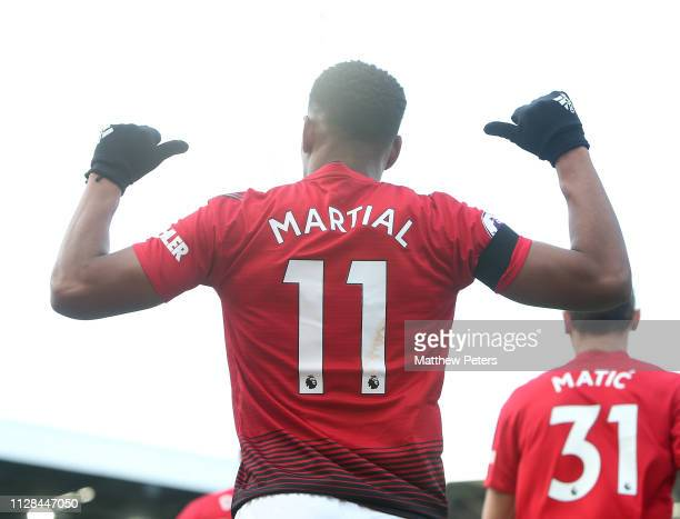 Anthony Martial of Manchester United celebrates scoring their second goal during the Premier League match between Fulham FC and Manchester United at...
