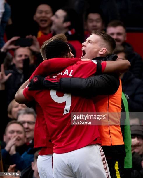 Anthony Martial of Manchester United celebrates scoring their second goal during the Premier League match between Manchester United and Watford FC at...