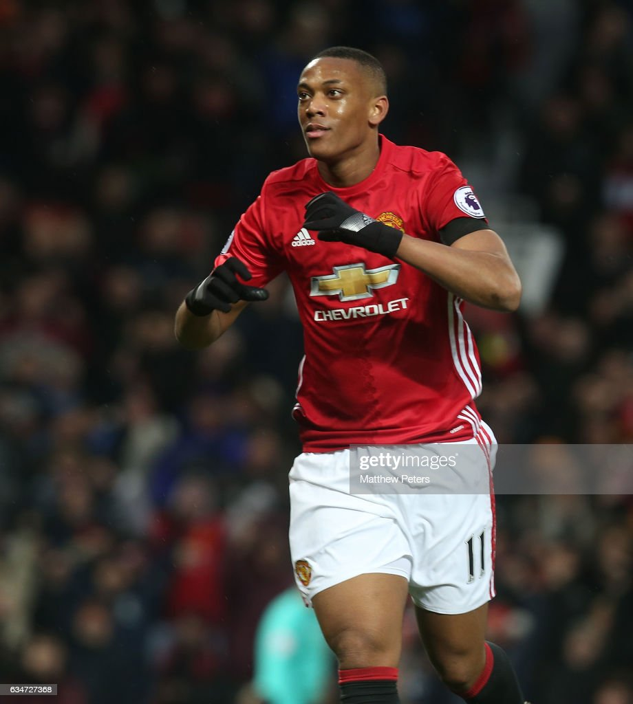 Anthony Martial of Manchester United celebrates scoring their second goal during the Premier League match between Manchester United and Watford at Old Trafford on February 11, 2017 in Manchester, England.
