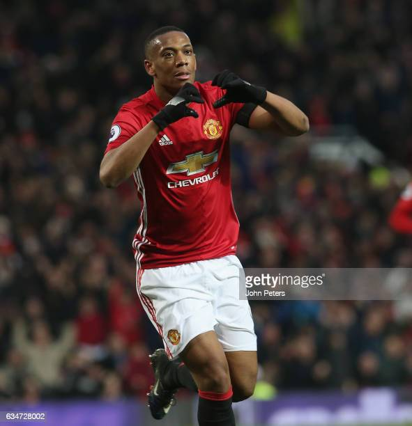 Anthony Martial of Manchester United celebrates scoring their second goal during the Premier League match between Manchester United and Watford at...