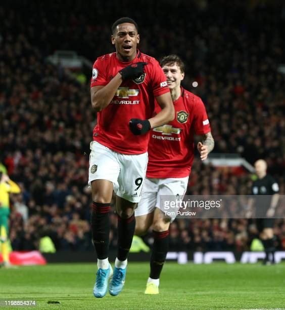 Anthony Martial of Manchester United celebrates scoring their third goal during the Premier League match between Manchester United and Norwich City...