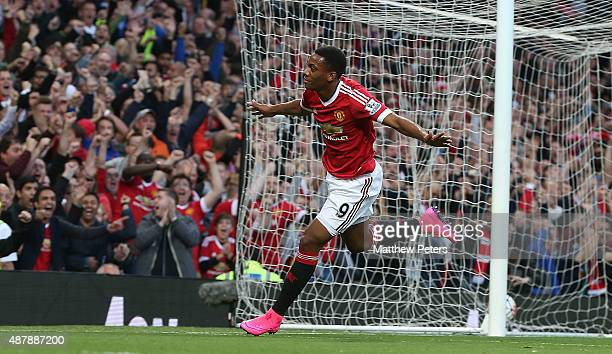 Anthony Martial of Manchester United celebrates scoring their third goal during the Barclays Premier League match between Manchester United and...