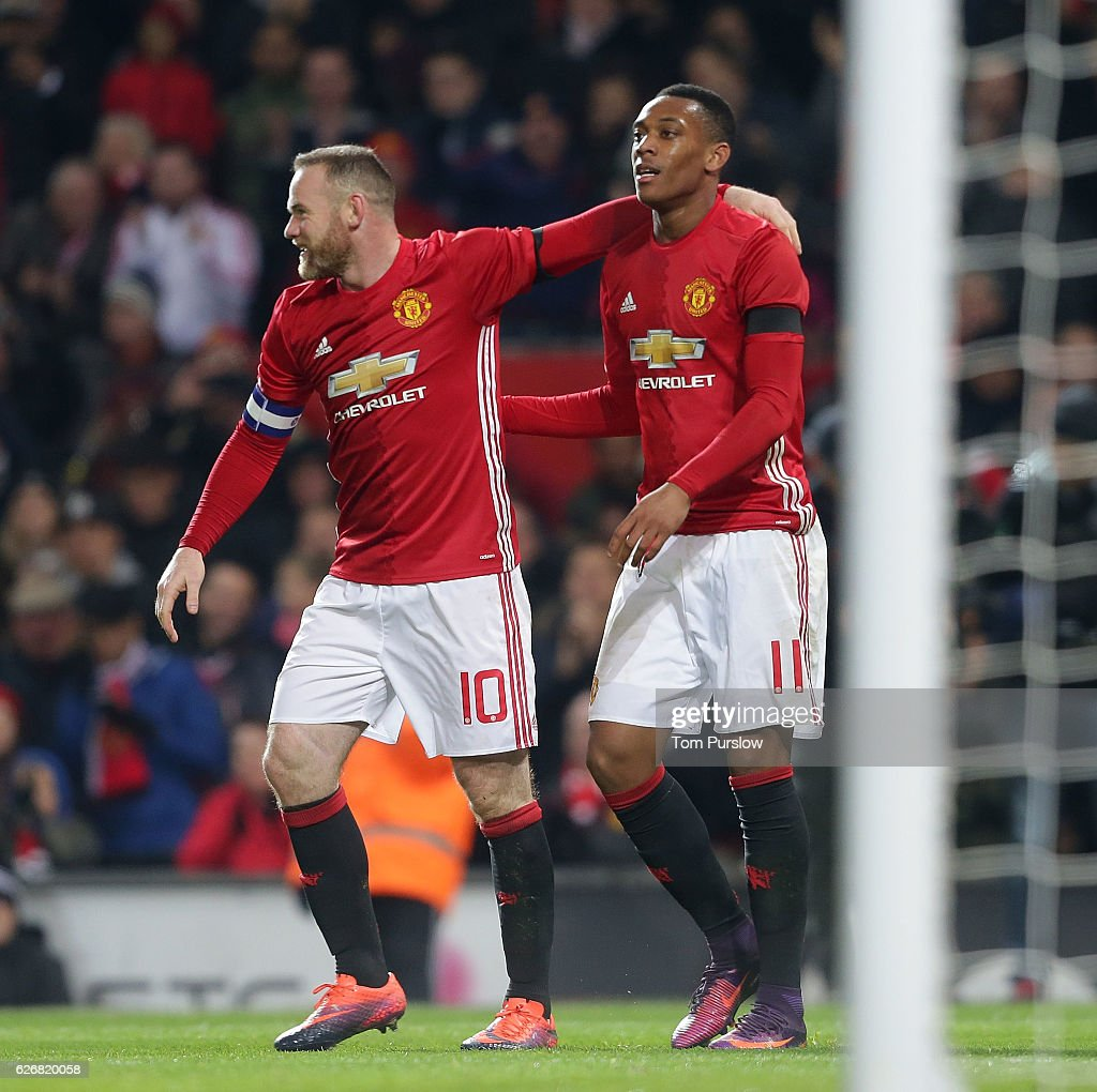 Anthony Martial of Manchester United celebrates scoring their third goal during the EFL Cup Quarter-Final match between Manchester United and West Ham United at Old Trafford on November 30, 2016 in Manchester, England.