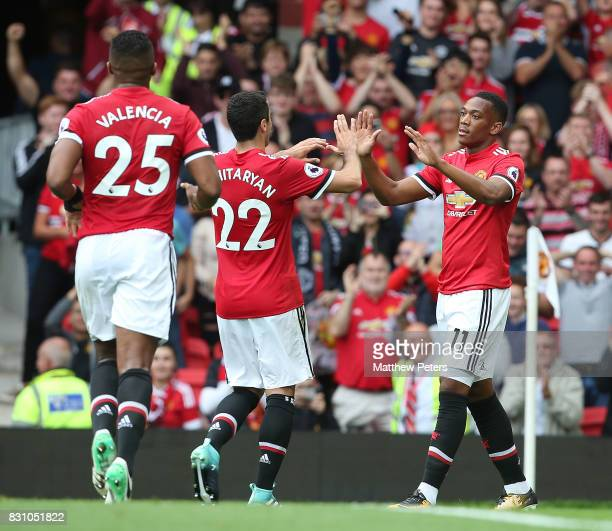 Anthony Martial of Manchester United celebrates scoring their third goal during the Premier League match between Manchester United and West Ham...