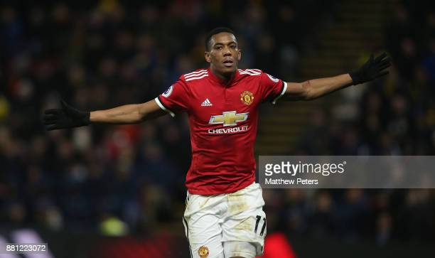 Anthony Martial of Manchester United celebrates scoring their third goal during the Premier League match between Watford and Manchester United at...
