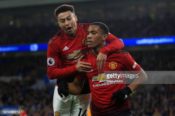 Anthony Martial of Manchester United celebrates scoring thier 3rd goal with Jesse Lingard during the Premier League match between Cardiff City and...