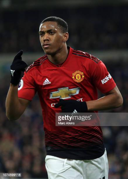 Anthony Martial of Manchester United celebrates scoring tier 3rd goal during the Premier League match between Cardiff City and Manchester United at...