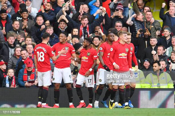 Anthony Martial of Manchester United celebrates with his team after scoring his sides first goal during the Premier League match between Manchester...