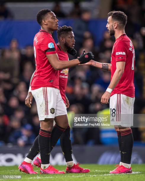 Anthony Martial of Manchester United celebrates with his team mates Fred and Bruno Fernandes after scoring goal during the Premier League match...