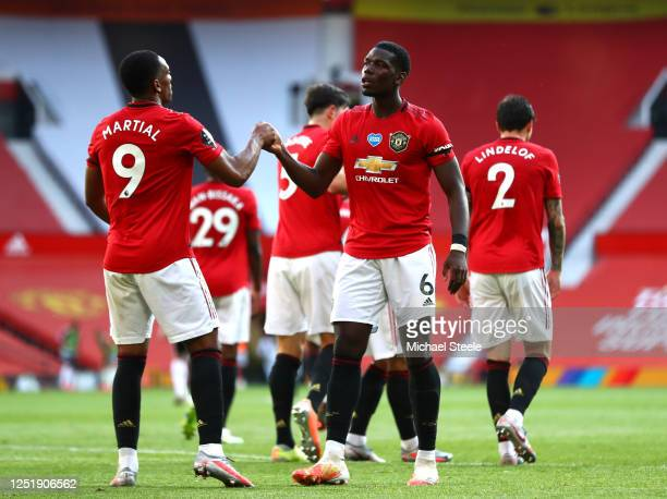 Anthony Martial of Manchester United celebrates with Paul Pogba after scoring his team's third goal during the Premier League match between...