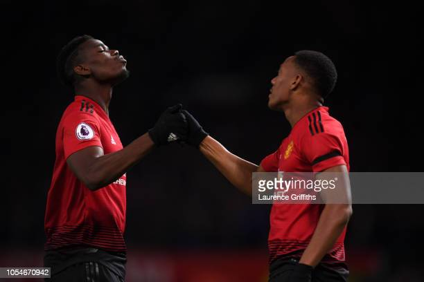 Anthony Martial of Manchester United celebrates with team mate Paul Pogba after scoring their team's second goal during the Premier League match...