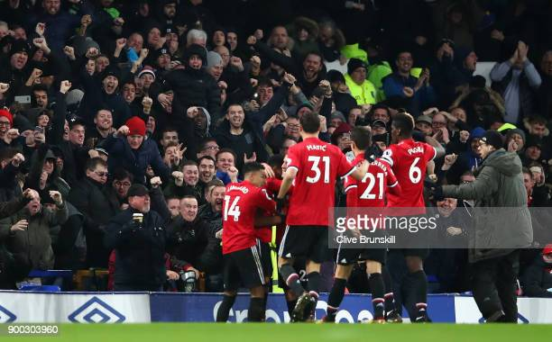Anthony Martial of Manchester United celebrates with team mates after scoring his sides first goal during the Premier League match between Everton...
