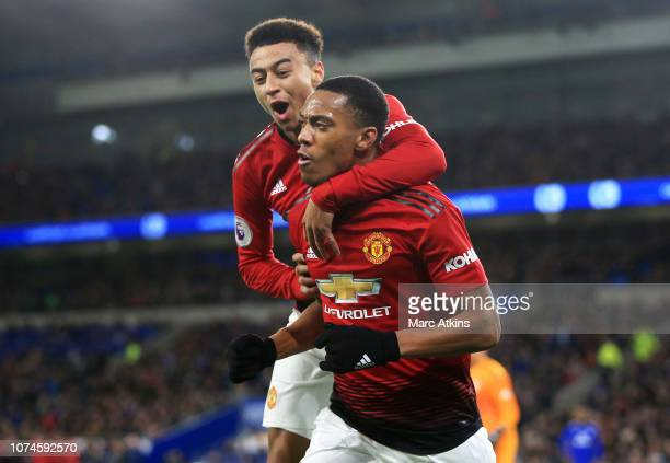 Anthony Martial of Manchester United celebrates with teammate Jesse Lingard after scoring his team's third goal during the Premier League match...