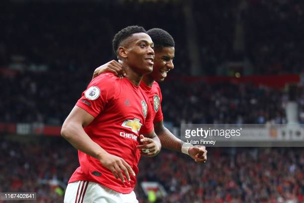 Anthony Martial of Manchester United celebrates with teammate Marcus Rashford after scoring his team's second goal during the Premier League match...