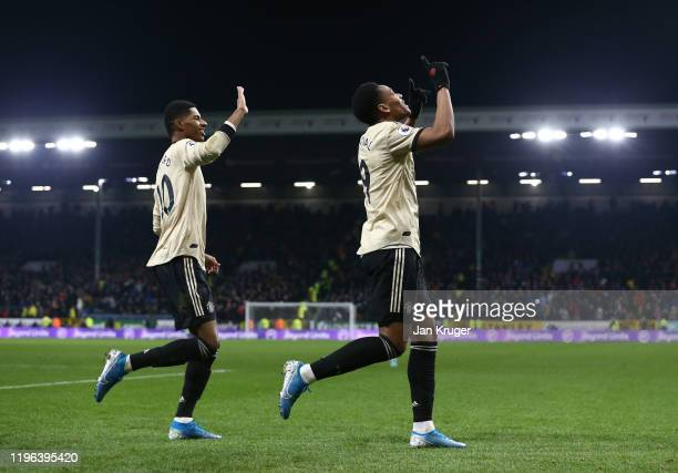 Anthony Martial of Manchester United celebrates with teammate Marcus Rashford after scoring his teams first goal during the Premier League match...