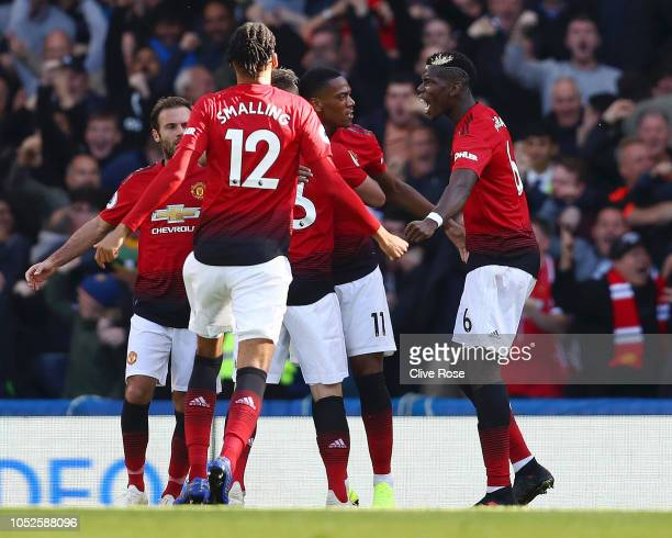 Anthony Martial of Manchester United celebrates with teammates after scoring his team's first goal during the Premier League match between Chelsea FC...