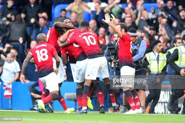Anthony Martial of Manchester United celebrates with teammates after scoring his team's second goal during the Premier League match between Chelsea...