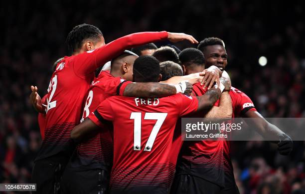 Anthony Martial of Manchester United celebrates with teammates after scoring his team's second goal during the Premier League match between...