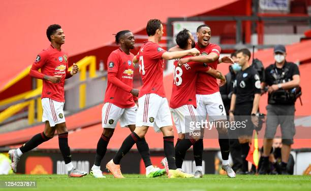 Anthony Martial of Manchester United celebrates with teammates after scoring his team's third goal during the Premier League match between Manchester...