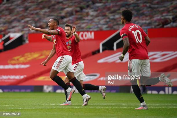 Anthony Martial of Manchester United celebrates with teammates Bruno Fernandes and Marcus Rashford of Manchester United after scoring his team's...
