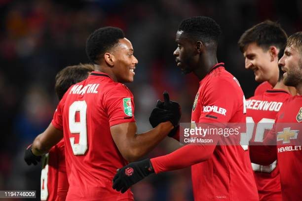 Anthony Martial of Manchester United celebrates with teammates Juan Mata, Eric Bailly, Luke Shaw and Harry Maguire of Manchester United after scoring...