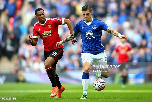 Anthony Martial of Manchester United chases down Muhamed Besic of Everton during The Emirates FA Cup semi final match between Everton and Manchester...