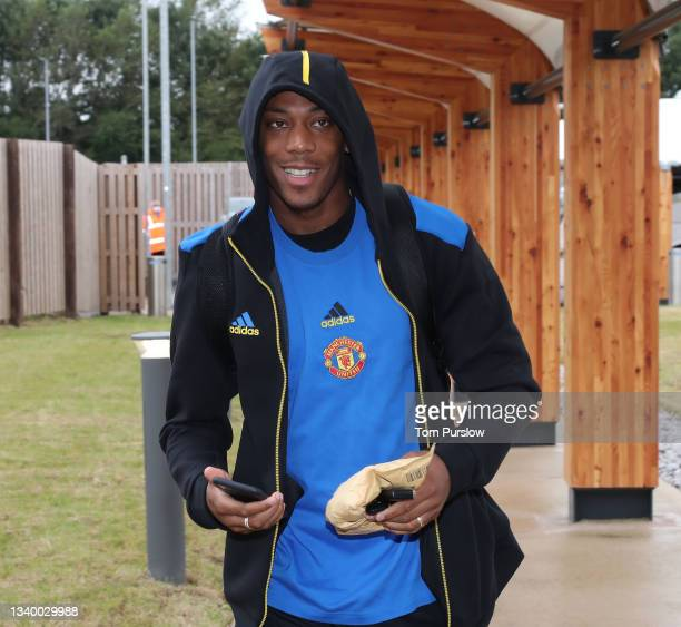Anthony Martial of Manchester United checks in ahead of their flight to Bern at Manchester Airport on September 13, 2021 in Manchester, England.