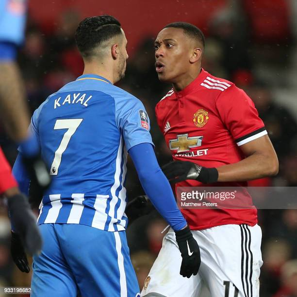 Anthony Martial of Manchester United clashes with Beram Kayal of Brighton Hove Albion during the Emirates FA Cup Quarter Final match between...
